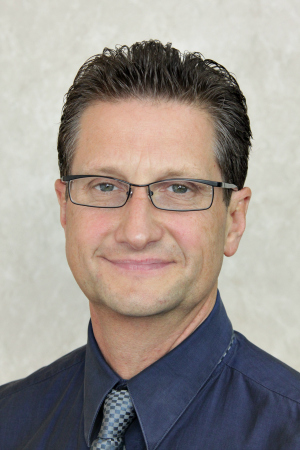 Dr.Michael Riskevich